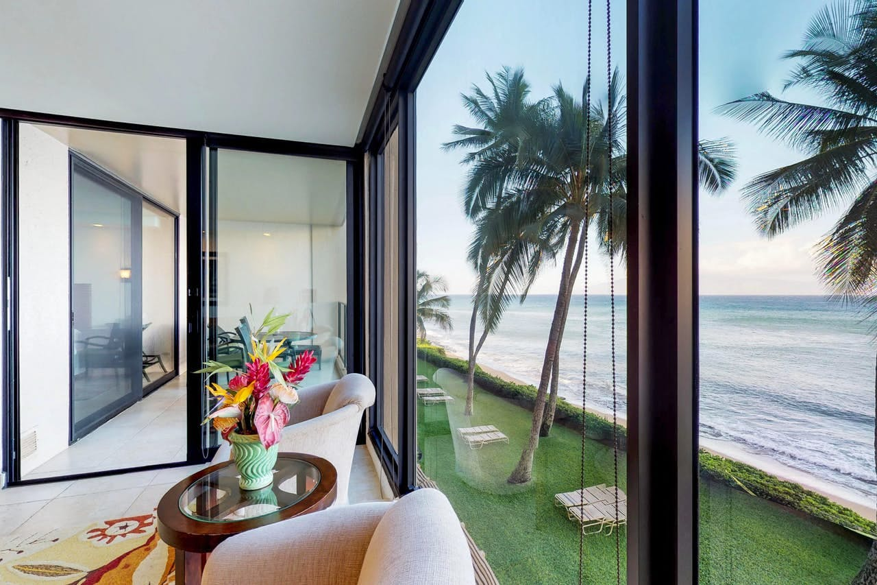 View of lush landscape, beach and ocean from Lahaina condo rental
