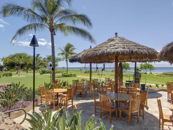 Lahaina resort with outdoor seating and lush landscaping