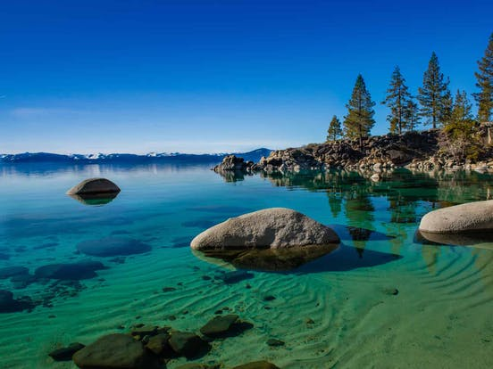 Clear blue water and surrounding landscape at Lake Tahoe