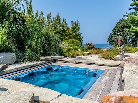 Outdoor hot tub of vacation home with views of Lake Michigan