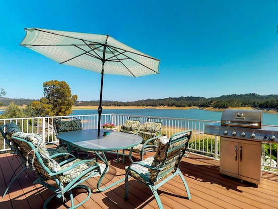 Deck of a California lakefront vacation home with a grill