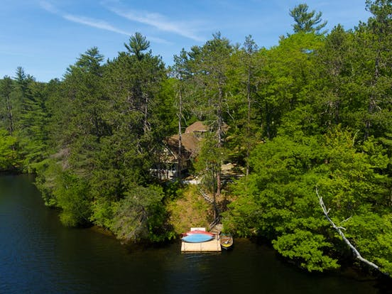 New England lakefront vacation rental with kayaks and dock