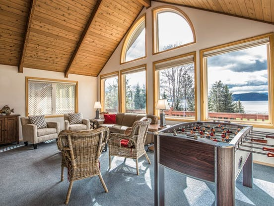 living area of Sandpoint, ID vacation rental with foosball table and awesome lake views