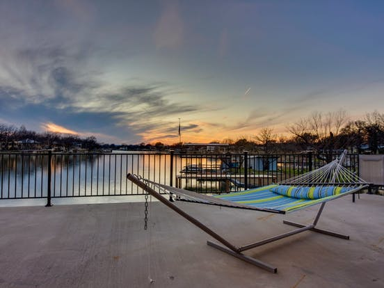 hammock outside a Texas vacation rental with lakefront views