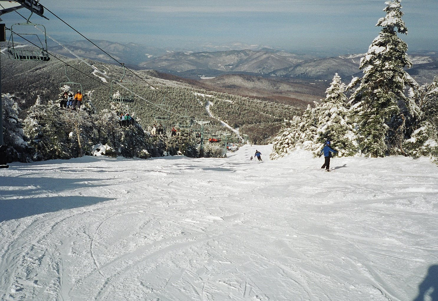 skiers going down a run at North Ridge of Killington Resort