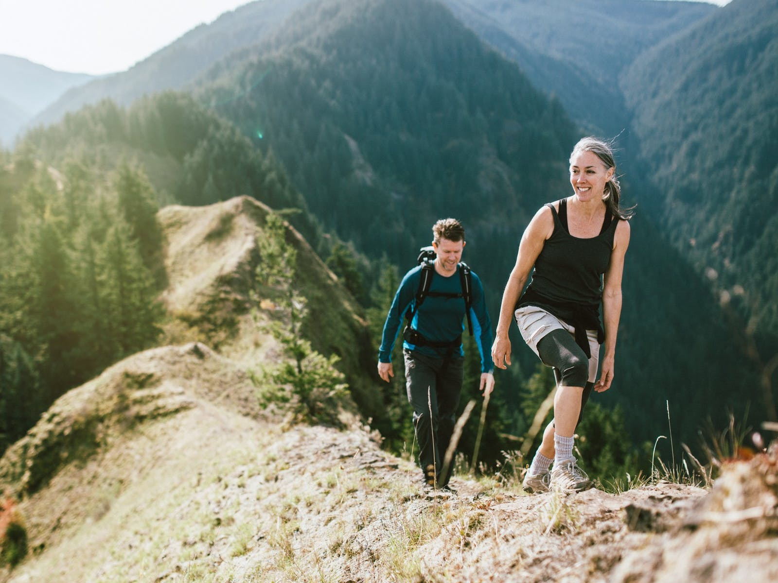 Two people hiking in the Colorado mountains