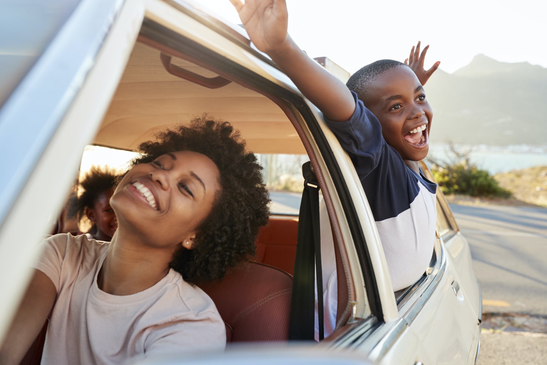 Family enjoying a car ride