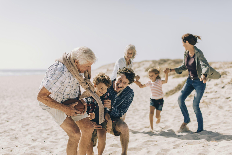 Multi-generational family having fun at the beach