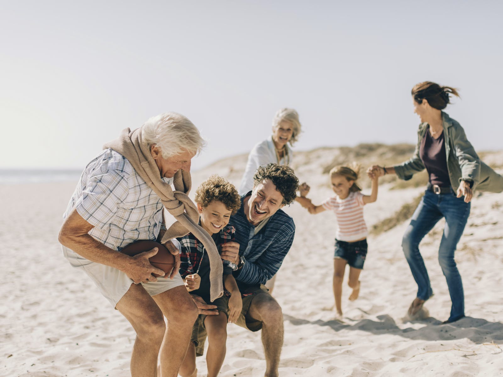 Multi-generational family having fun at the beach