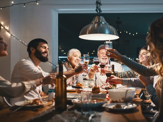 Friends raising their glasses to celebrate their holiday meal