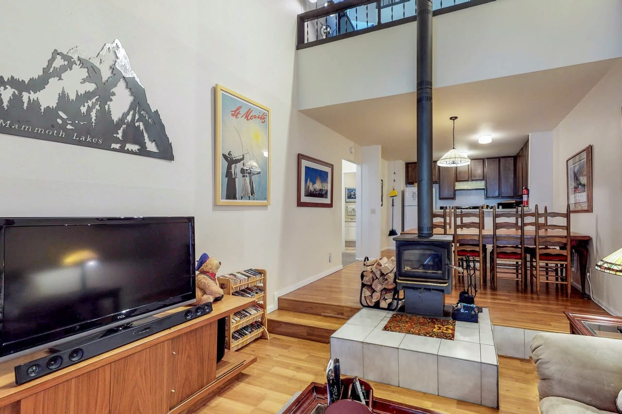 Ski-related wall decor and wood-burning fireplace in Mammoth Lakes, CA vacation rental