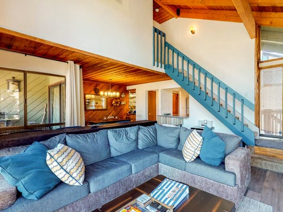 Stylish blue couch and matching blue decor inside this Mammoth Lakes, CA vacation condo