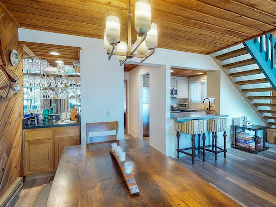 Wood paneling and mirrored bar area inside this Mammoth Lakes, CA vacation condo