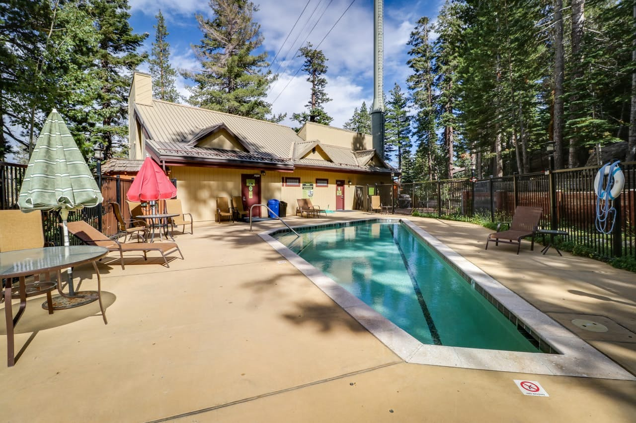 Shared outdoor pool with plenty of lounge seating in Mammoth Lakes, CA