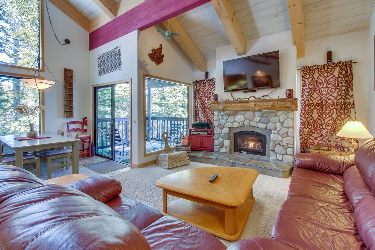 Mammoth Lakes, CA forest views from spacious living area with fireplace and ample seating