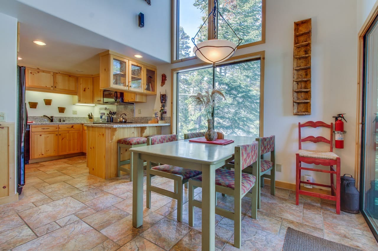 Kitchen and dining area with floor-to-ceiling windows offering beautiful view of Mammoth Lakes, CA