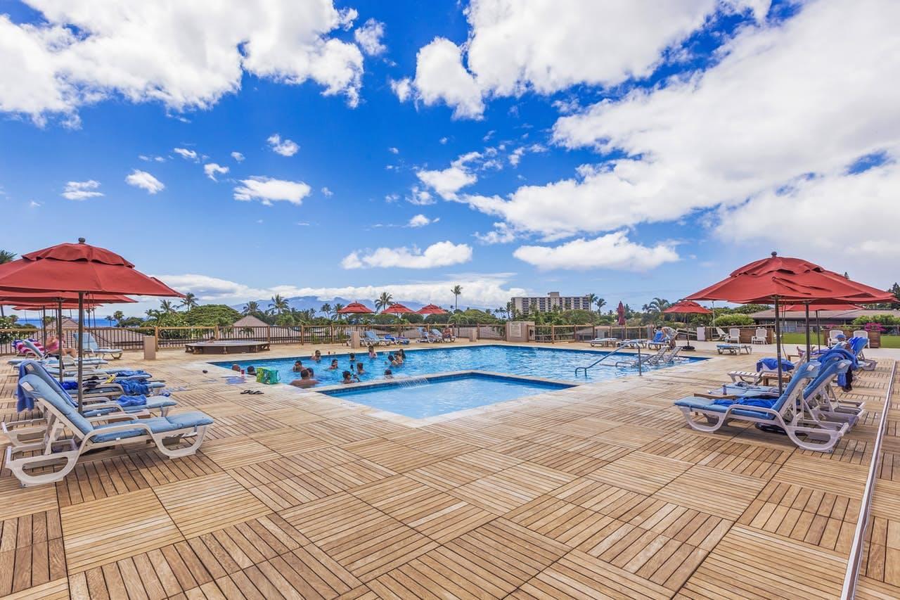 people swimming in the pool at Maui Eldorado Resort