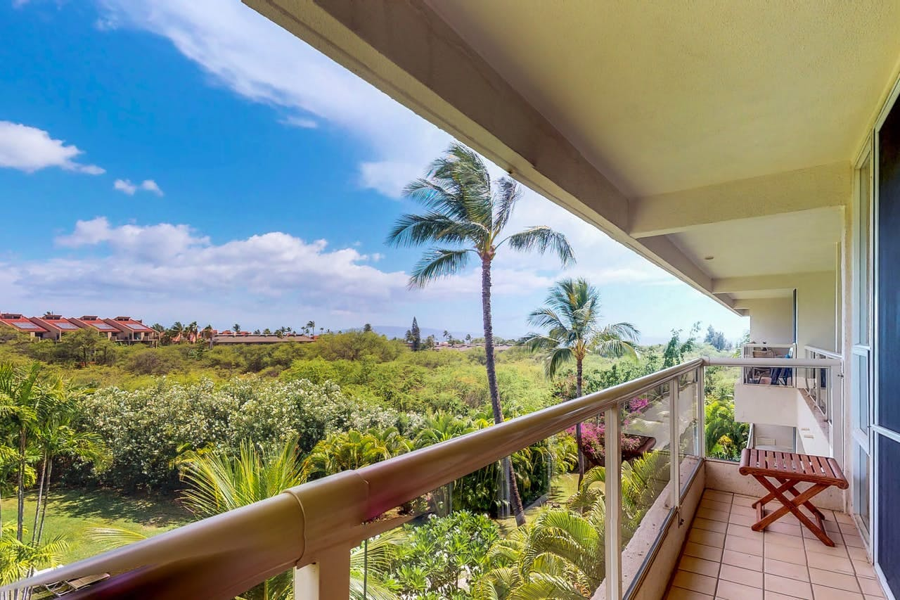 a view of the maui tropical forest from a condo rental at Maui Banyan