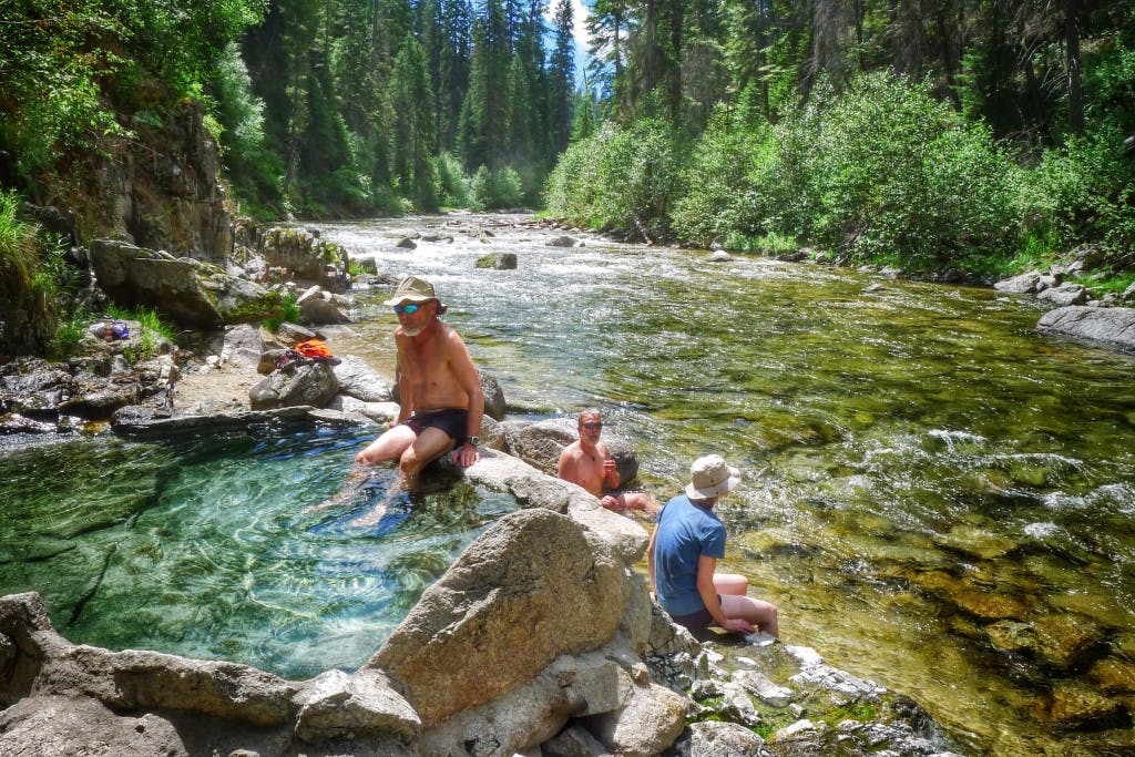 a group relaxing in Mile-16 Hot Spring