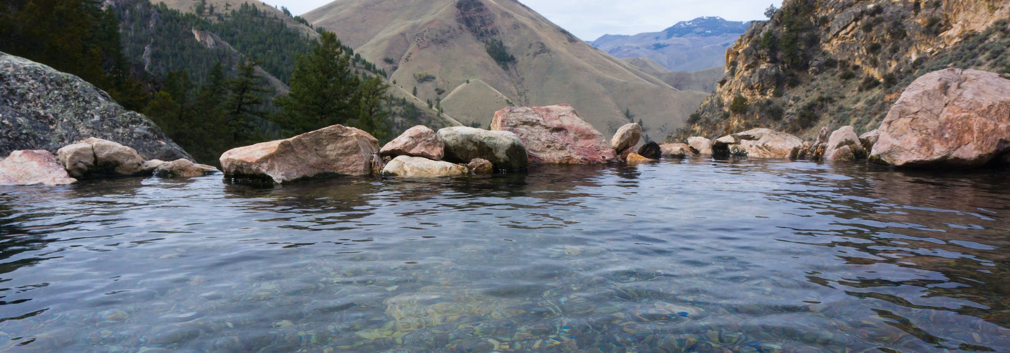 a hot spring overlooking a scenic landscape