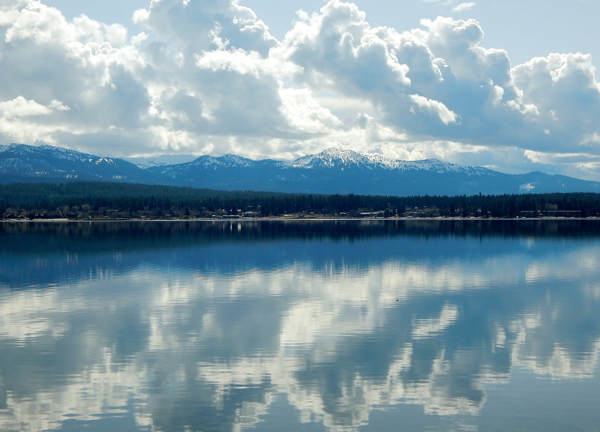 clouds reflecting from still water on Payette Lake