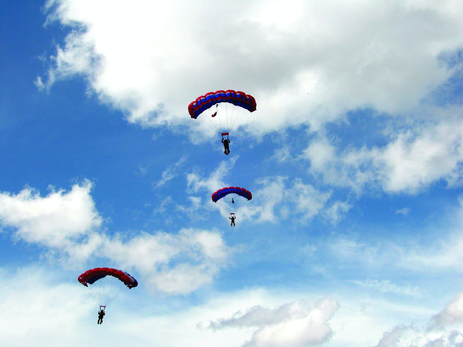 smokejumpers parachuting to the ground at the McCall smokejumper base