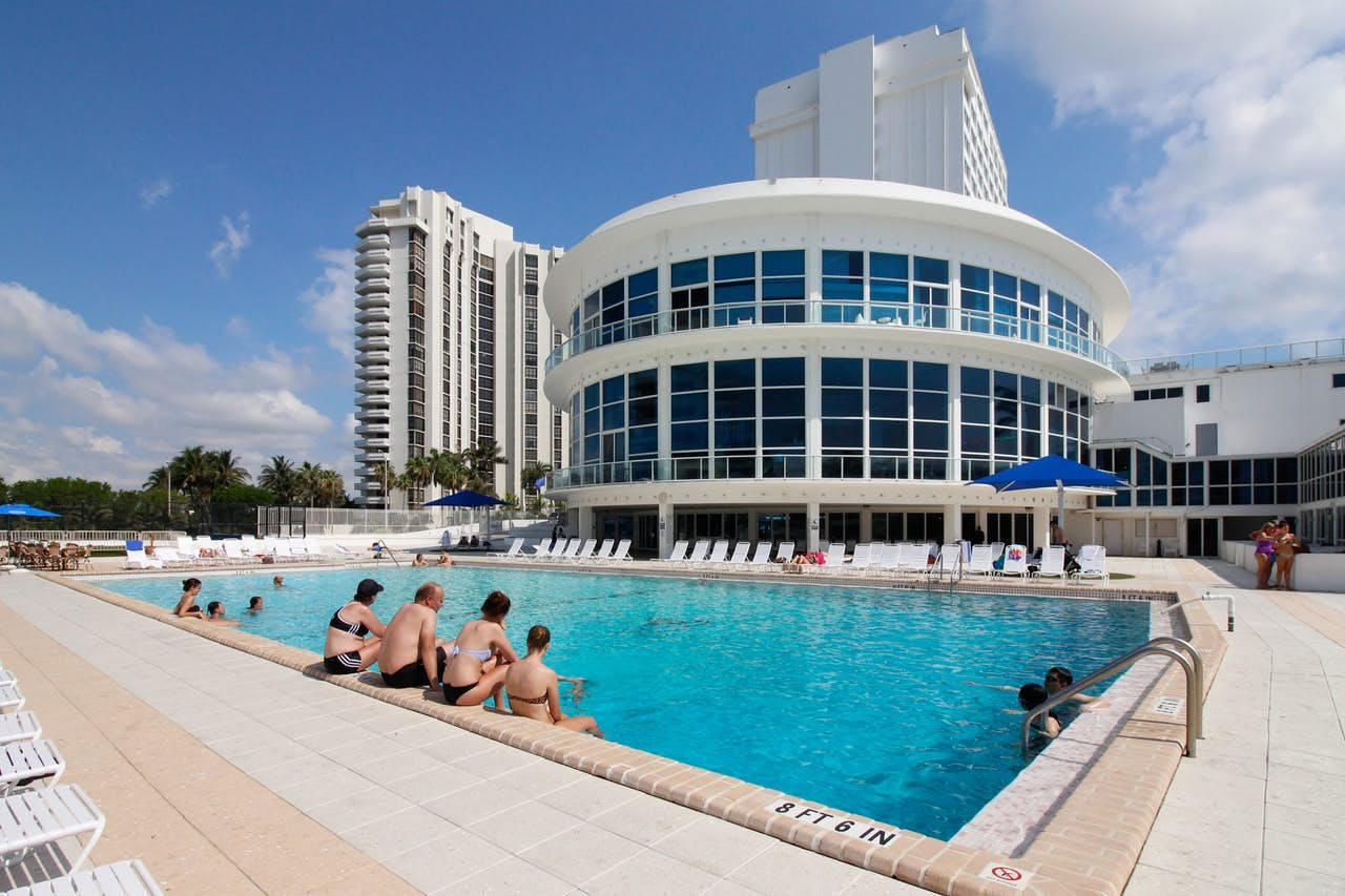 people sitting in the pool at a Miami Beach resort