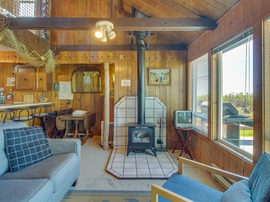 Interior of Moclips, WA vacation rental with ocean views and wood burning stove