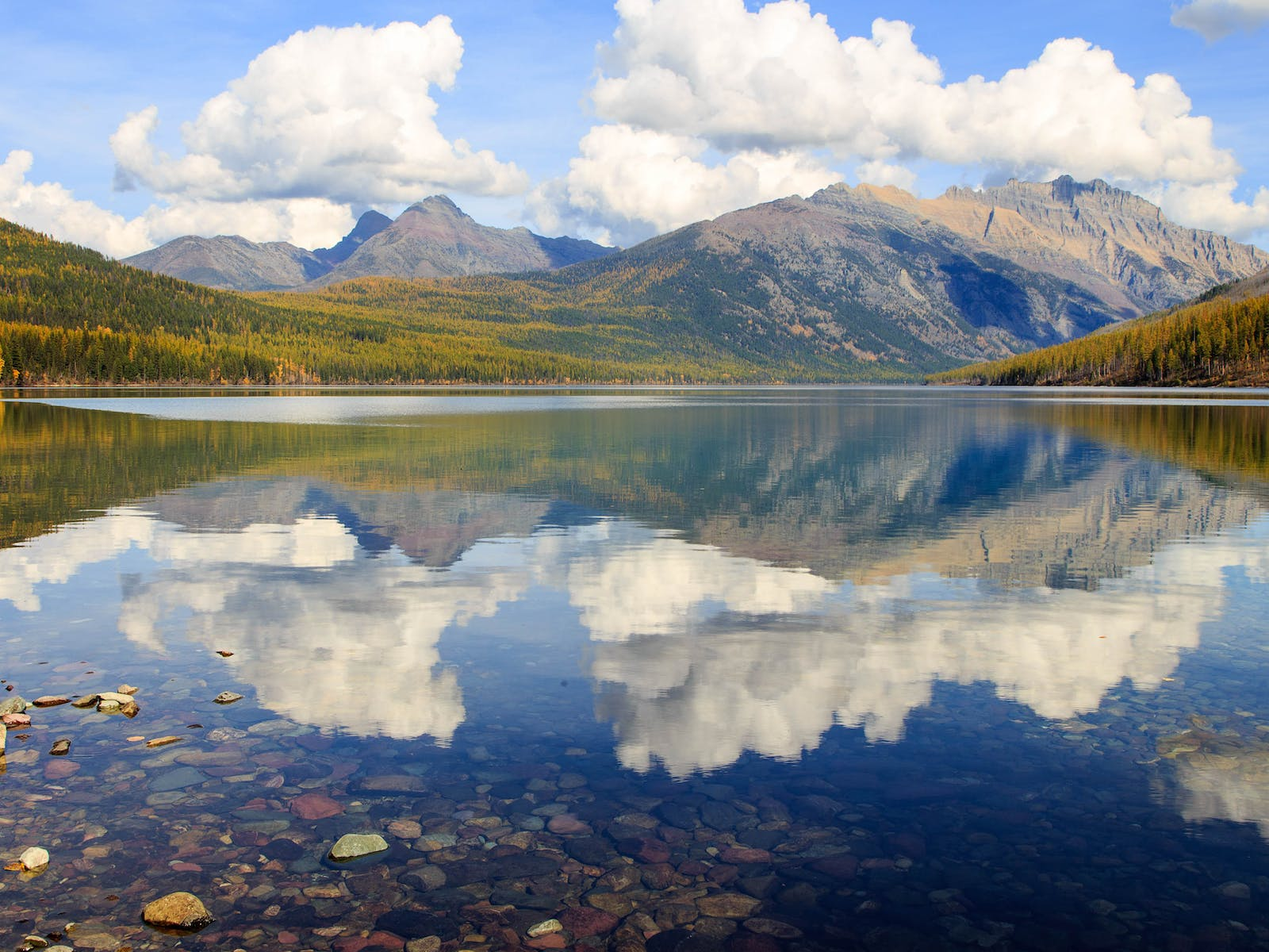 western montana mountains reflected in body of water