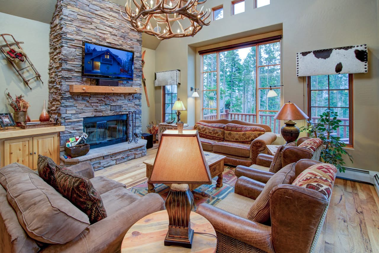 a cabin in big sky that has a antler chandelier in the living room