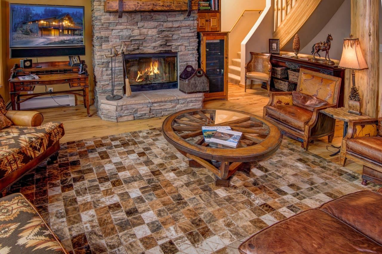 a fireplace crackling in a cozy big sky cabin