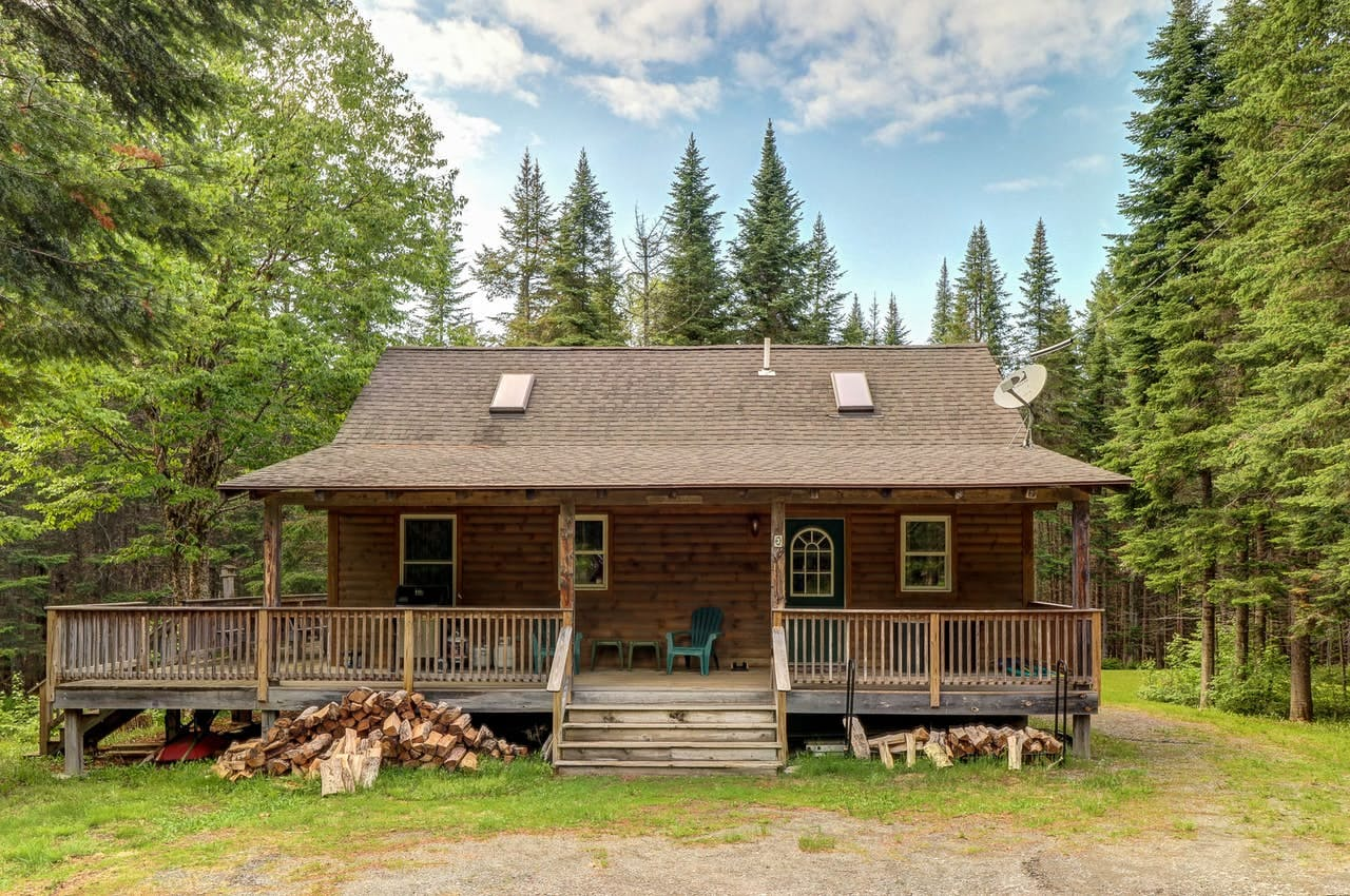 the front porch of a cabin near moosehead lake