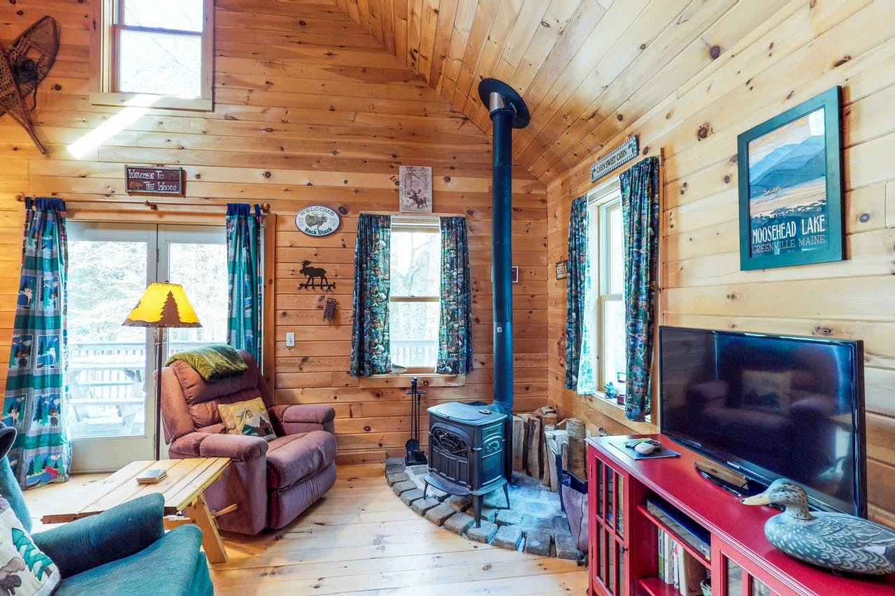 an old wood burning fireplace in a cozy cabin