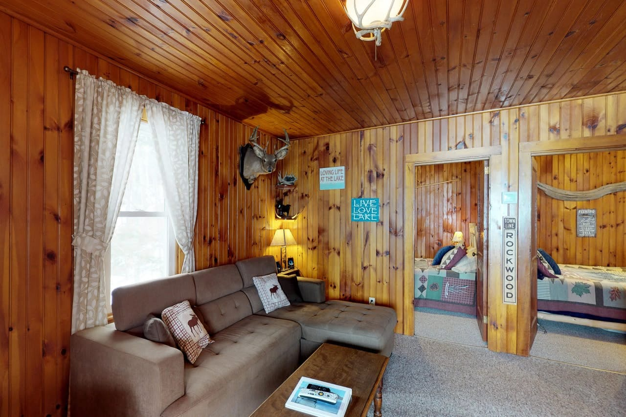 a cabin's living room in moosehead lake