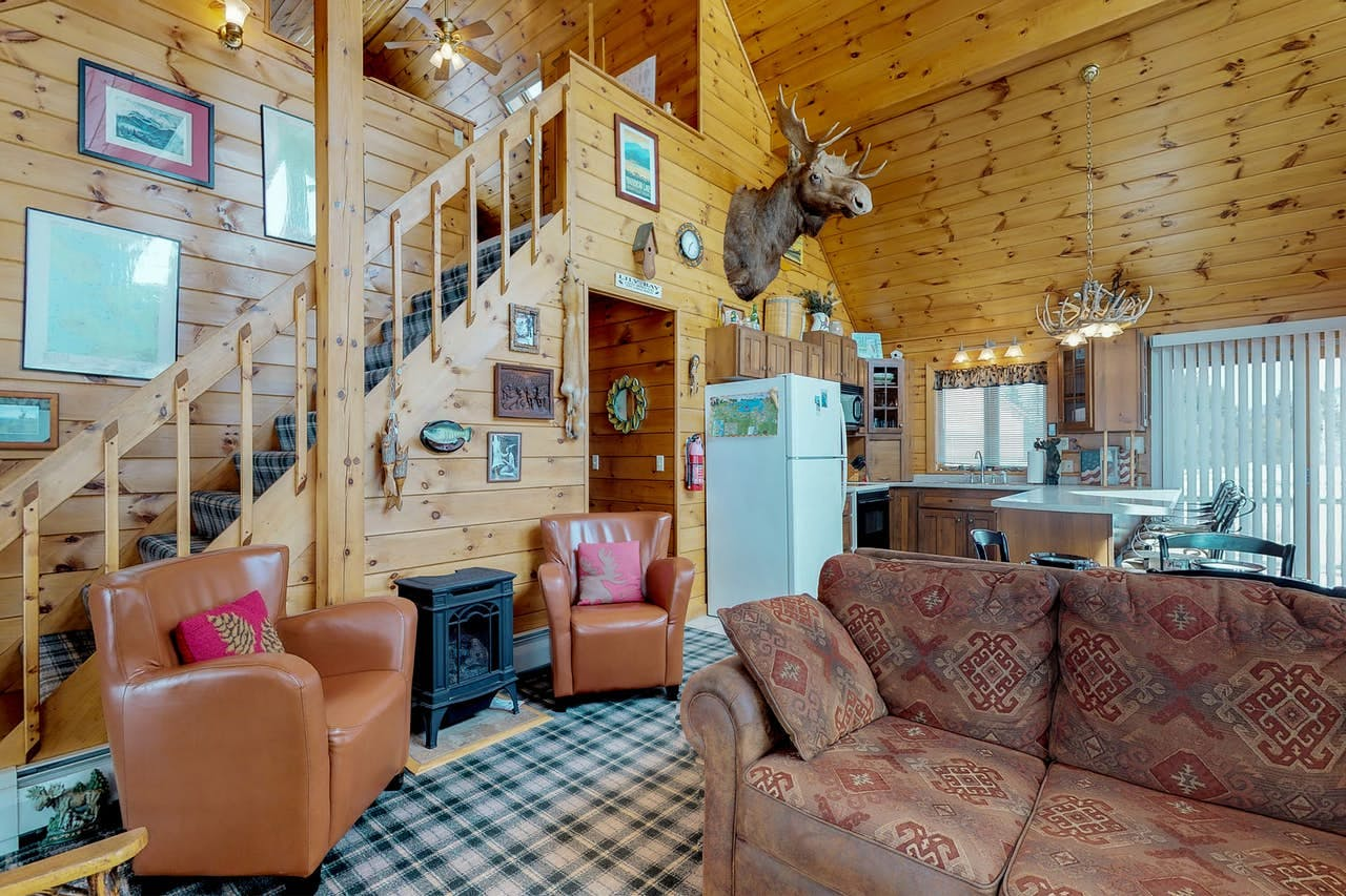 a cabin in moosehead lake that has a moose head on the wall