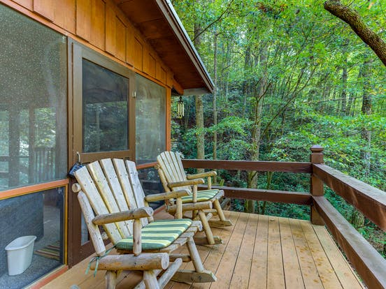 Morgantown vacation rental balcony with forest background
