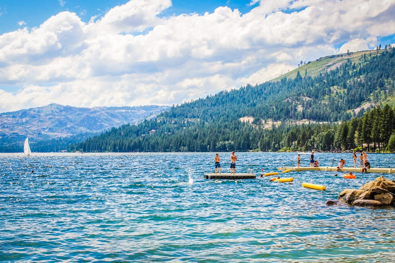 kids playing on the dock and swimming in lake tahoe
