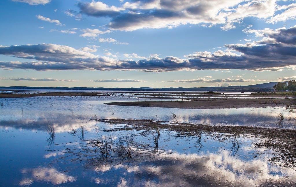 the clouds reflecting off of Sebago Lake, ME