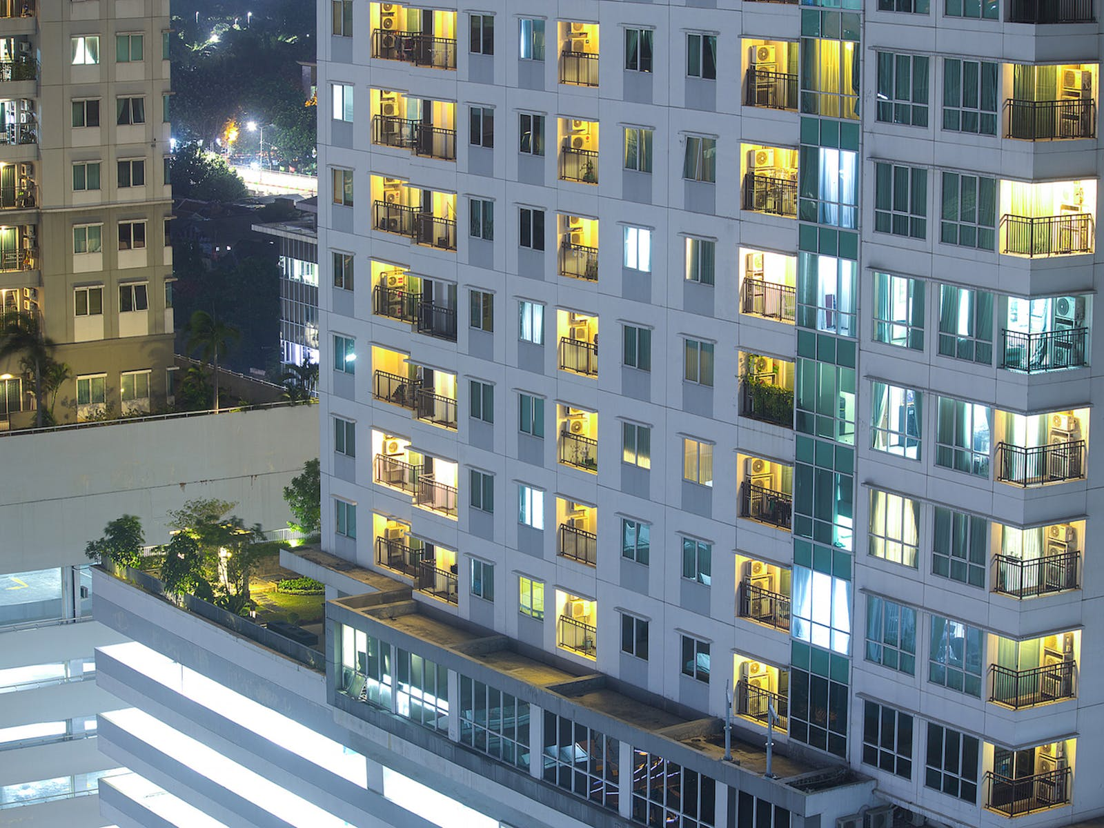 a new multifamily unit with the lights on at night