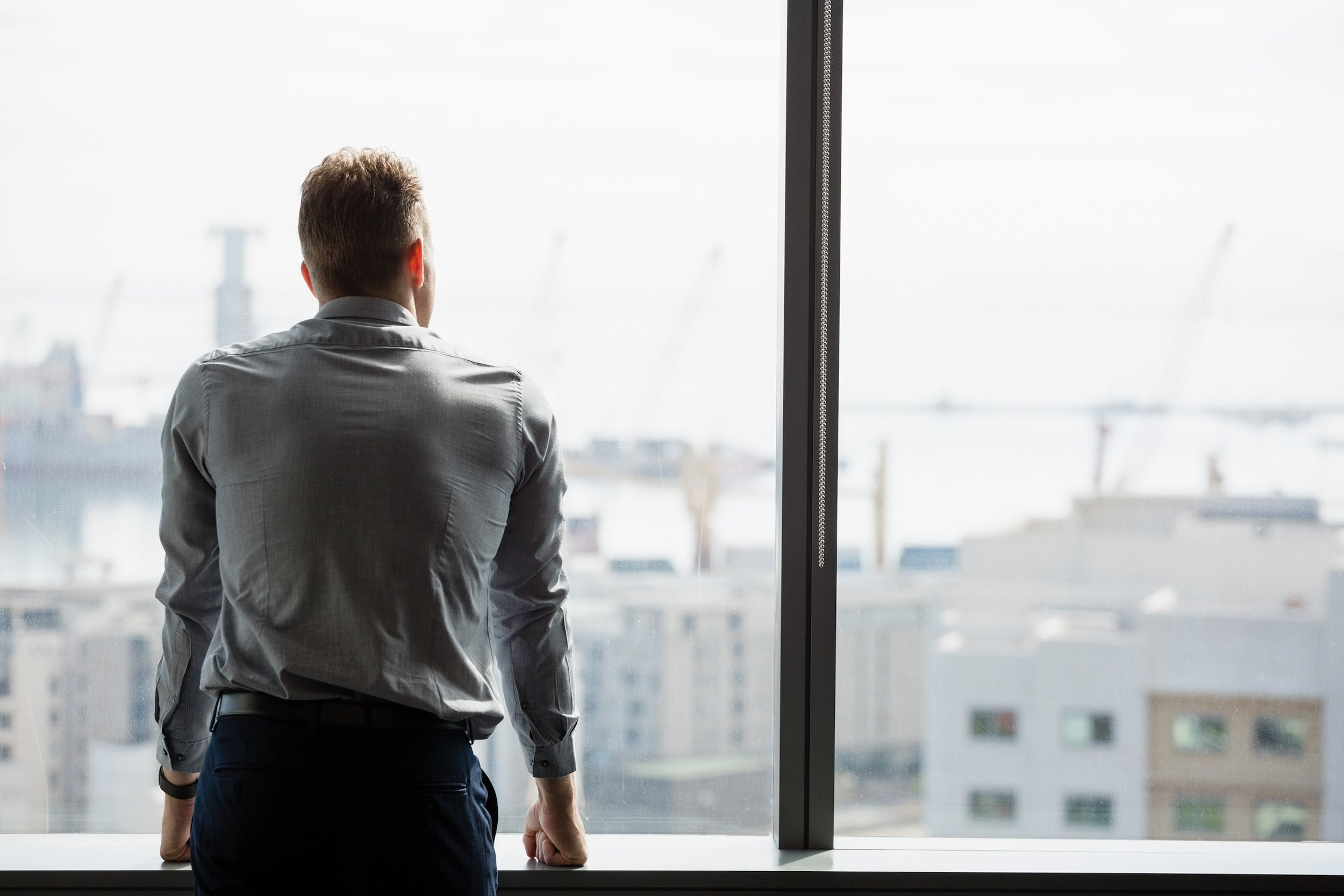 a man in a condo overlooking the city