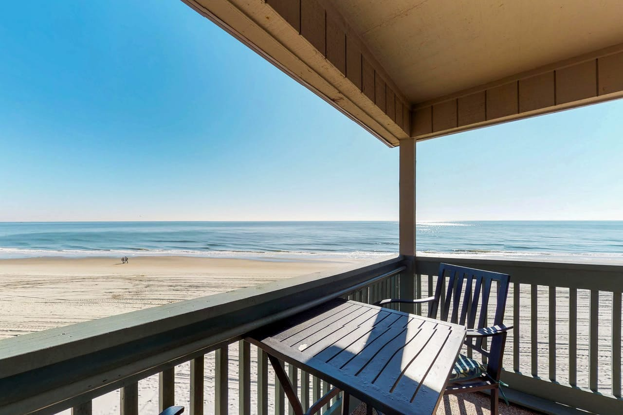 Shaded balcony with ocean views and access to the beach in Myrtle Beach, SC