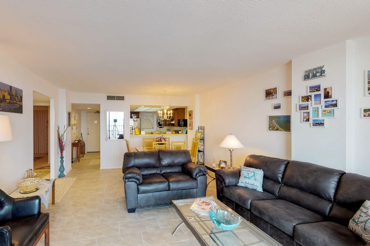 Myrtle beach vacation condo with plenty of couches and kitchen/dining area