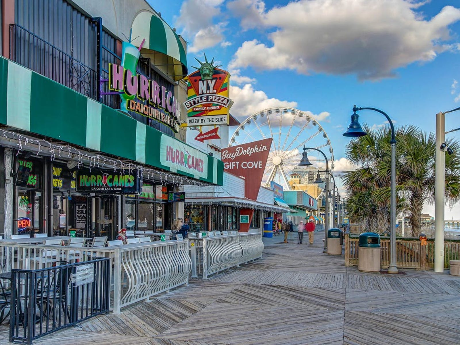 boardwalk with storefronts in myrtle beach
