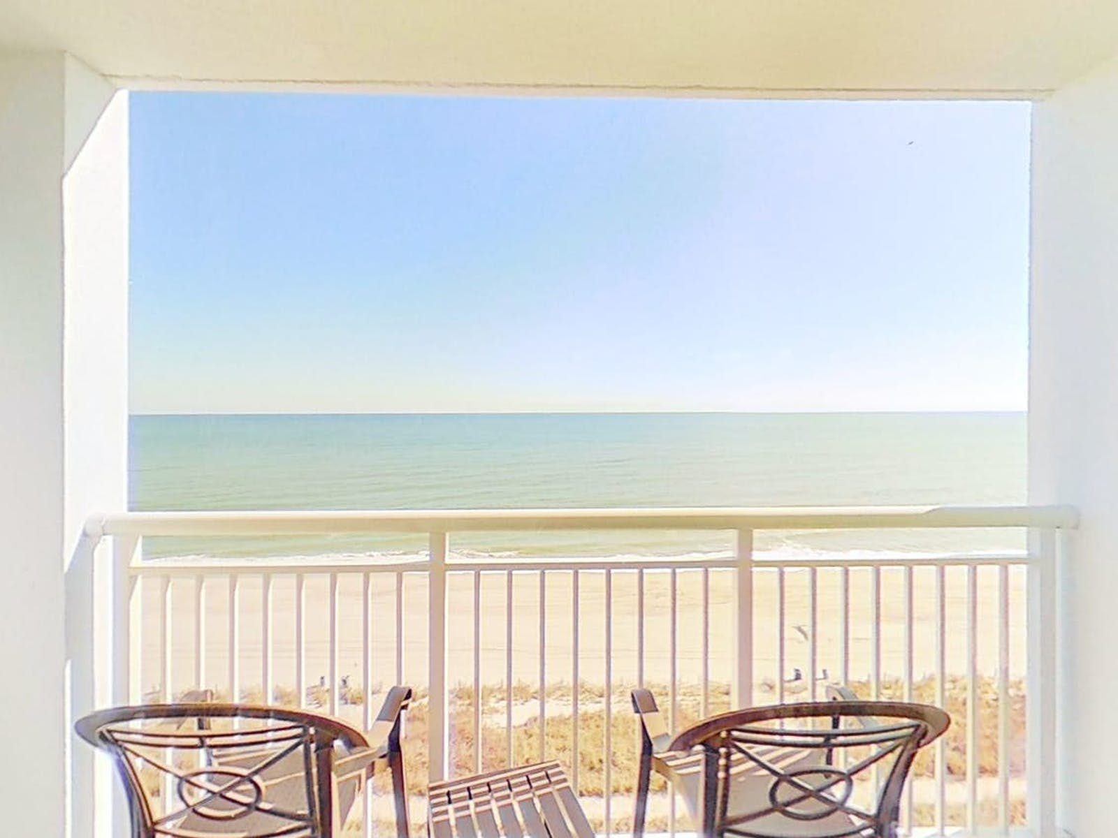 balcony of condo rental inside Camelot by the Sea