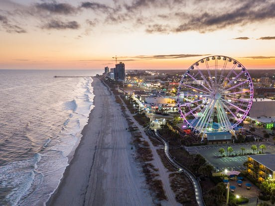 Aerial view of Myrtle Beach, SC with ocean, beach, boardwalk and ferris wheel
