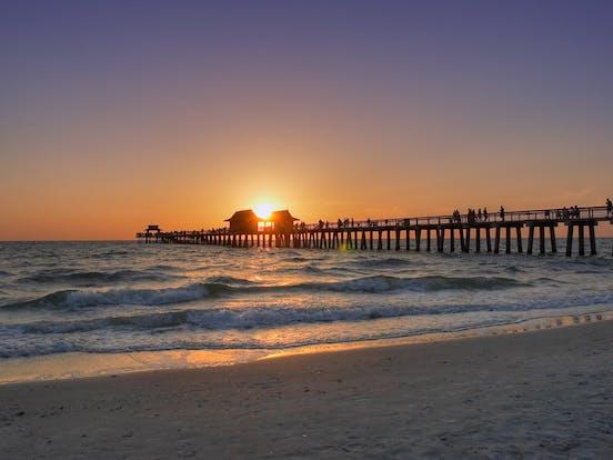 Sunset over a boardwalk in Naples, FL