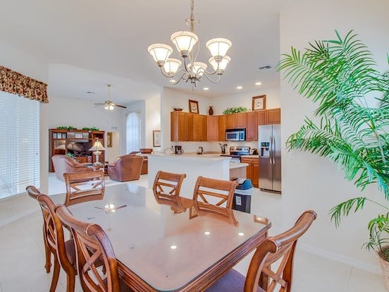 Bright kitchen and dining area of vacation rental with modern furnishings