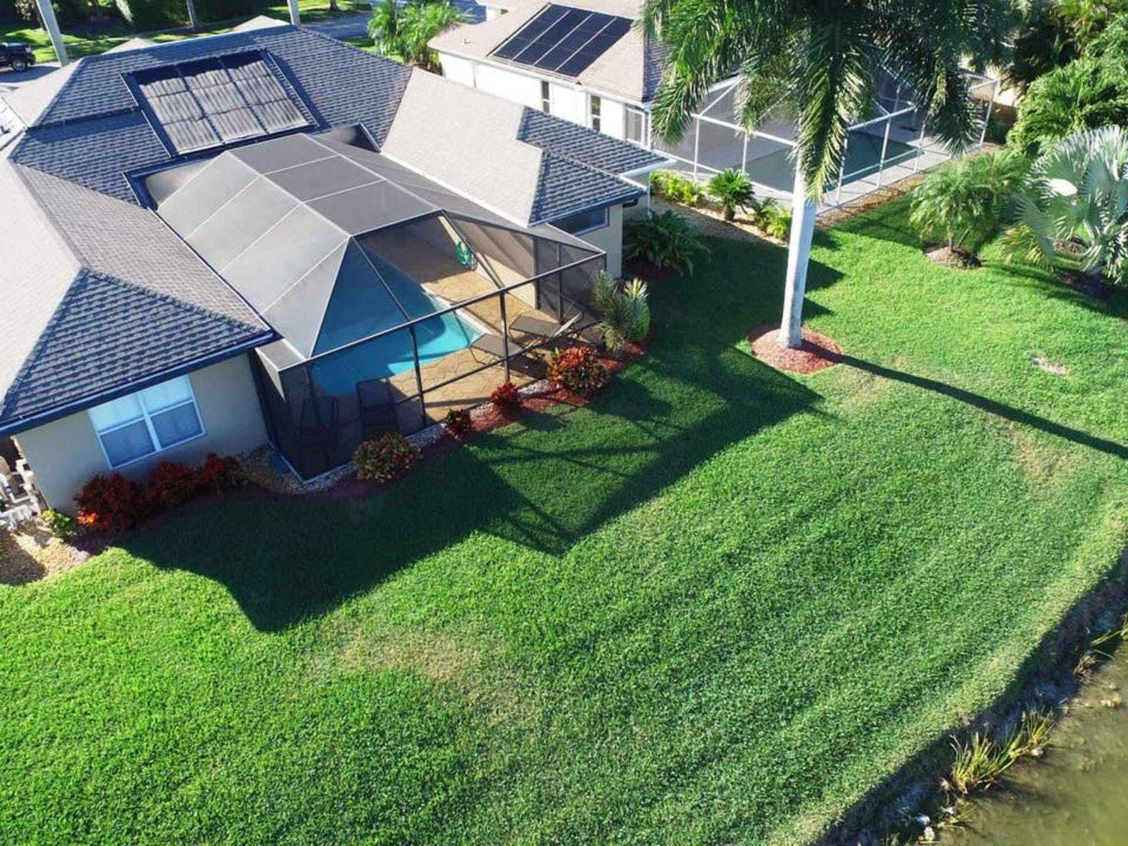 Vacation home rental in Naples with enclosed pool and manicured lawn