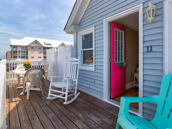 Balcony with plenty of outdoor seating at Ocean City, MD triplex vacation rental