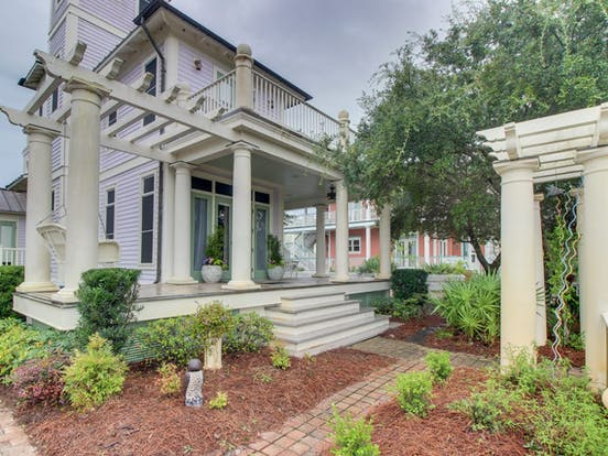 Vacation home in Orange Beach, AL with outdoor columns, porch swing and upstairs balcony